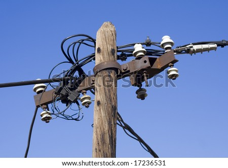 Old pole supporting electric wires