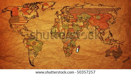 old political map of world with flag of madagascar - stock photo