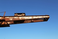 Old port crane rusts in the sun