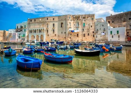 Old port of Monopoli province of Bari, region of Apulia, southern Italy. Boats in the marina of Monopoli.