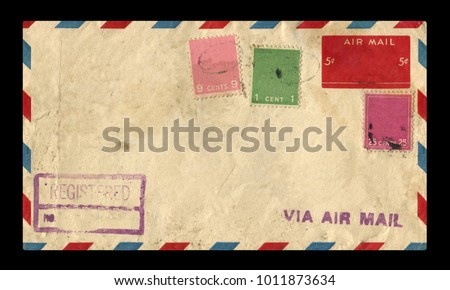 old postage envelope on a black background, message, air mail #1011873634