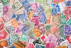 Old postage stamps from various countries as background