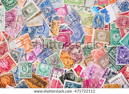 Old postage stamps from various countries as background #475722112