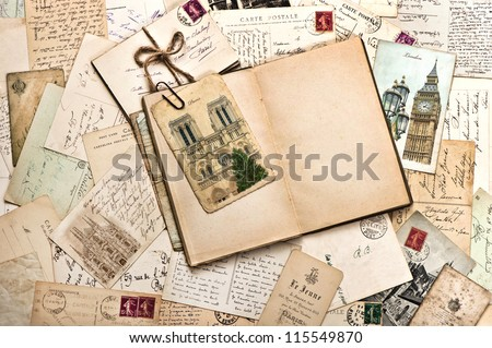 old postcards and open empty book. vintage travel background