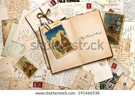 old postcards, letters, mails and open journal with sample text My Travel Book. vintage style travel background