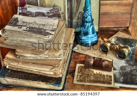 Old postcards, photos, correspondence,books,decanter and opera glasses on wooden background. - stock photo
