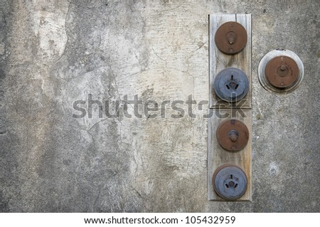 Old power switches on a grungy wall