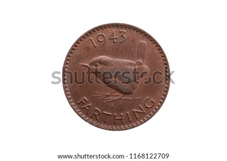 Old pre decimal 1943 George VI farthing coin of England UK reverse Wren cut out and isolated on a white background