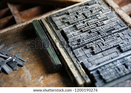 Old press printing industry. Macro photo from factory that is putting the letter for press by the ink. Letterpress is old technology.But the print is unique. So it is popular especially vintage lover.