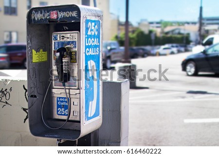 Old Public Pay Phone next to a Parking Lot