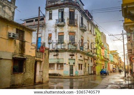 old quarters of Havana after the rain, sunset illuminating the colorful buildings stock photo