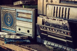 Old Radio , dusty old radio on a wooden table , Retro radio and audio cassette player