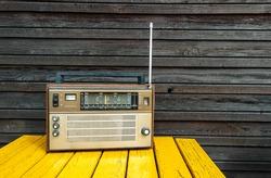 Old radio on yellow table