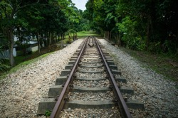 Old Railroad Tracks that dead end on a hiking path in Bukit Timah Nature Reserve, Singapore