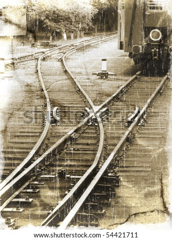 Old railroad with two railway tracks and their intersection (vintage style)