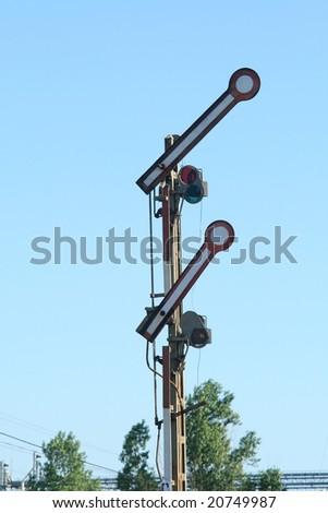 Old railway mechanical semaphore on the blue background