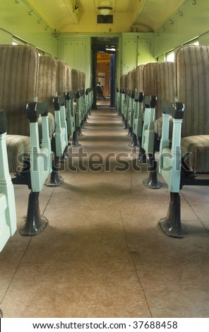 Old railway passenger car aisle seats