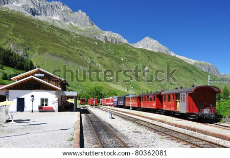 Old railway station in the Swiss Alps - stock photo
