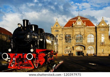 Old railway station with steam engine in front ( Arad, Romania, Europe)