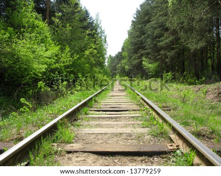 Old railway track in the forest, Russia