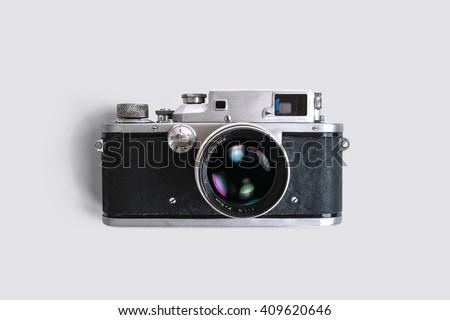 Old rangefinder camera on white background. Vintage style