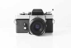 Old rangefinder vintage and retro photo camera isolated on white background