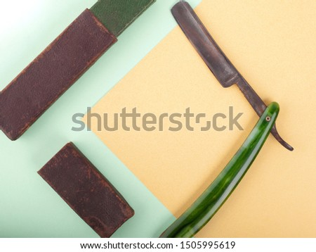 old razor blade.retro vintage haircut tools.barber set copy space closeup.