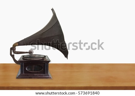 Old record player on wooden table isolate on white background #573691840