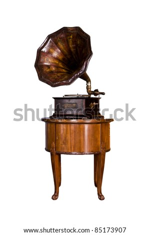 old record player over wood table on white background. Retro image