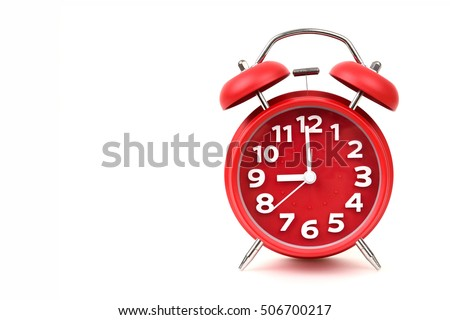Old red alarm clock, Red round alarm clock shows to 9. isolated on white background.