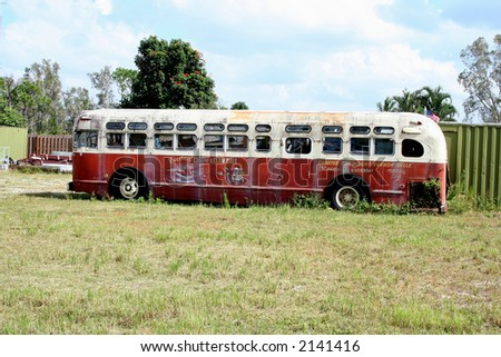 stock-photo-old-red-and-white-bus-parked