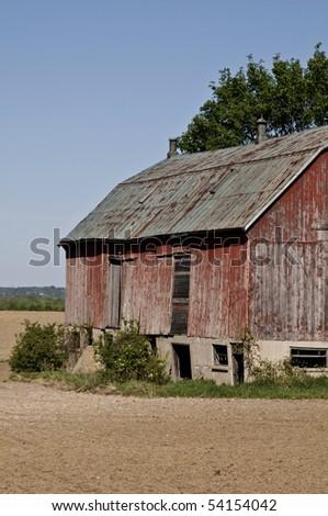 Old, red barn in open field