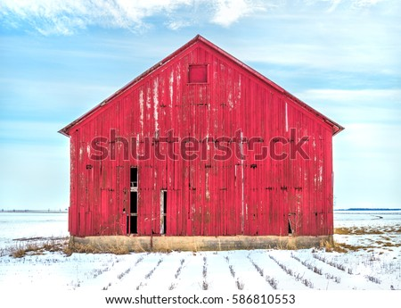 Old red barn in the snow in Midwest USA