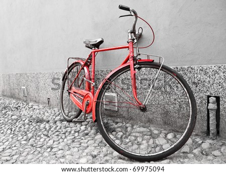 Old red bike selective colored - stock photo