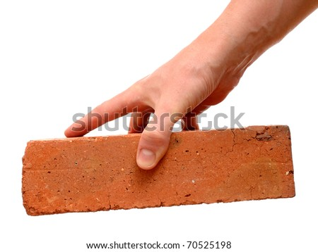 Old red brick in hand isolated on white background