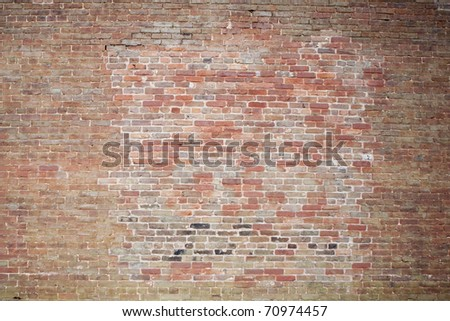 old red brick patched wall