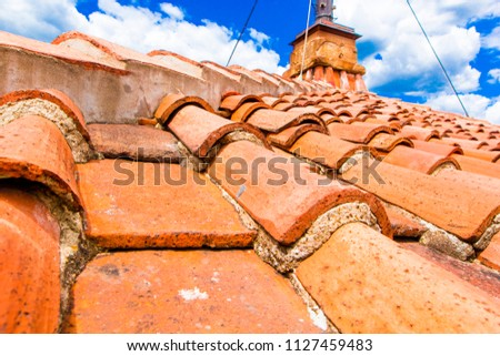 Old red brick roof tiles from north on roofs of Italian houses and churches, Florence, Tuscany, Italy #1127459483