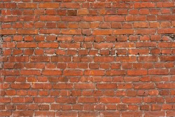 Old red brick wall background. Grunge brickwall texture. Empty abstract stonewall backdrop. Aged orange masonry with copy space