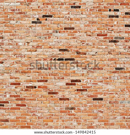 Old red brick wall fragment as a background texture