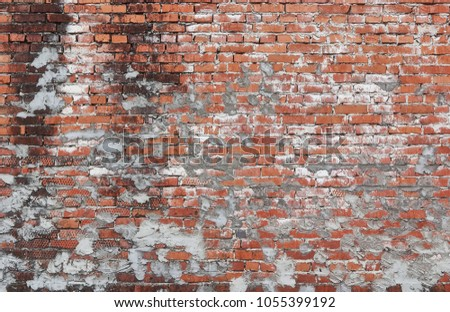 Old Red Brick Wall Frame Texture. Empty Brickwall Background. Fragment of Brick Masonry With Plaster Repair Traces.