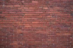 Old red brick wall. Grunge red vintage background.