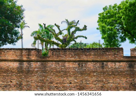 Old red brick wall of Fort Cornwallis in George Town Penang, Malaysia. Background with copy space. #1456341656
