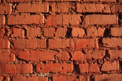 old red brick wall, on a sunny day