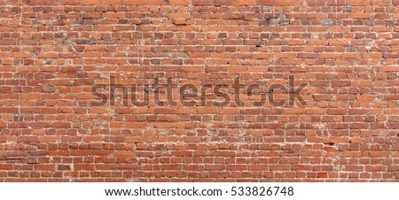 Old Red Brick Wall Wide Rough Texture. Solid Distressed Building Brown Facade Textured Urban Background.