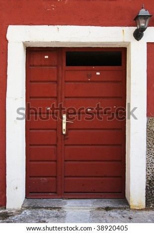 Old red door with lantern