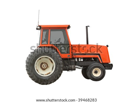 Old red farm tractor isolated on white