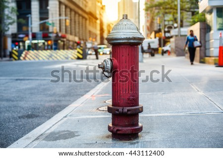 Old red fire hydrant in New York City street. Fire hidrant for emergency fire access