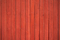 Old, red grunge wood vertical panels on a rustic barn