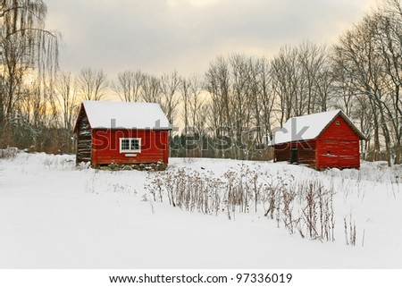 Old red houses in a snowy landscape. Swedish winter.