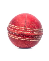Old red leather cricket ball isolated against a white background